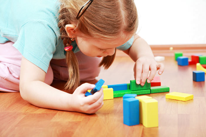 girl building with blocks at childcare